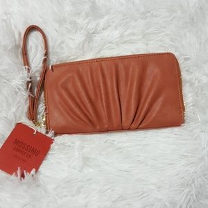 New burnt orange wristlet
